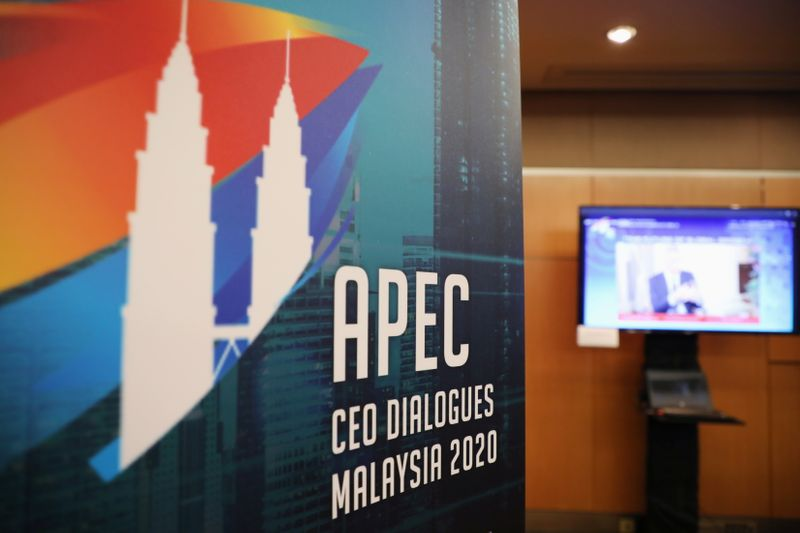A logo of APEC CEO Dialogues Malaysia 2020 is pictured at command center, in Kuala Lumpur