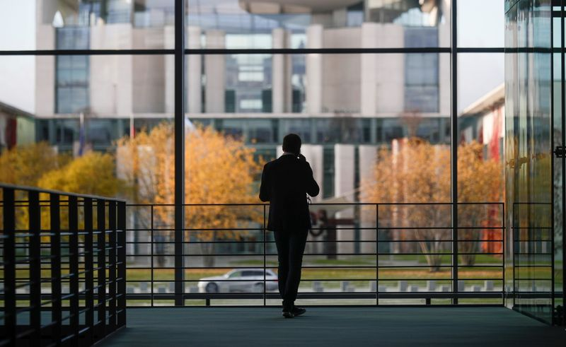 A man stands inside the Paul Loebe building ahead of the arrival of Wirecard's former boss