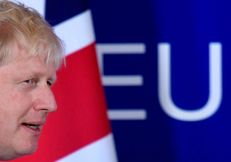 FILE PHOTO: Britain's Prime Minister Boris Johnson arrives to attend a news conference at the