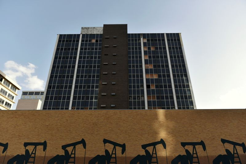 FILE PHOTO: A mural depicting oil wells is seen in front of an abandoned building in downtown