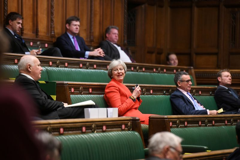 Britain's former Prime Minister Theresa May reacts during a debate at the House of Commons in