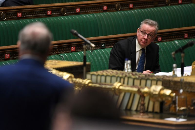 Britain's Chancellor of the Duchy of Lancaster Michael Gove looks on during a debate at the