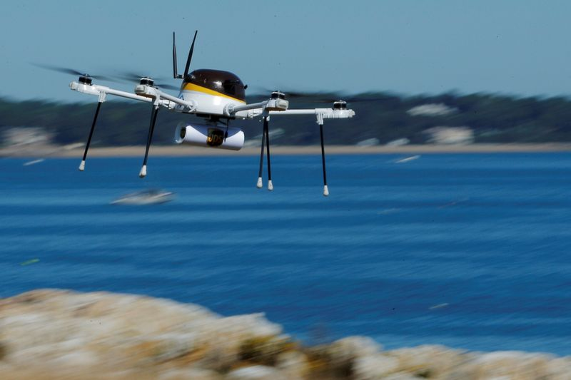 FILE PHOTO: A drone, made by CyPhy Works, carries a UPS package on Children's Island off the