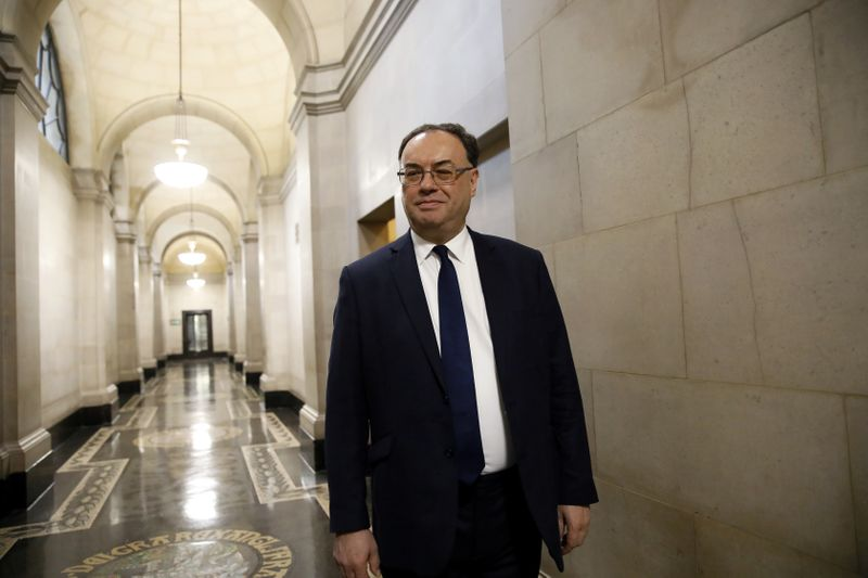 FILE PHOTO: Bank of England Governor Andrew Bailey poses for a photograph on the first day of