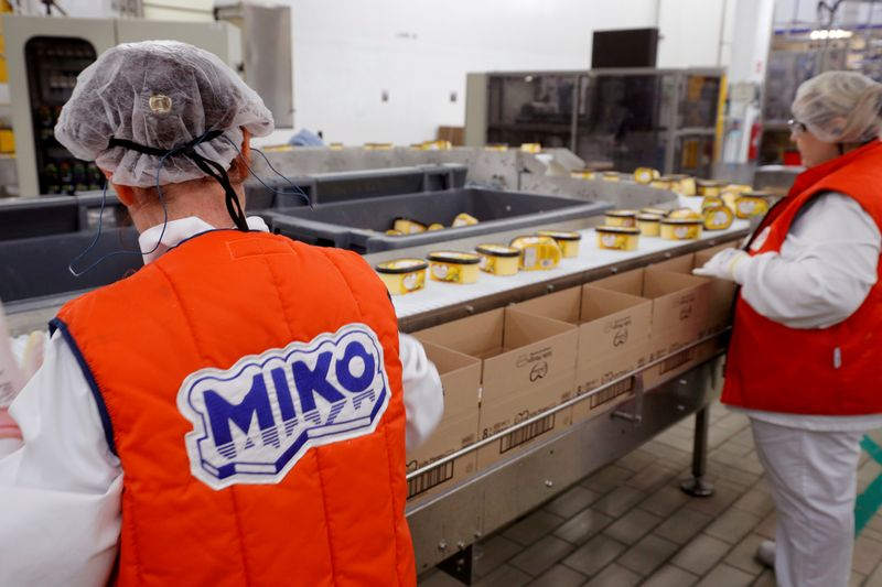 FILE PHOTO: Employees prepare boxes of ice cream at the Miko Carte d'Or, part of the Unilever