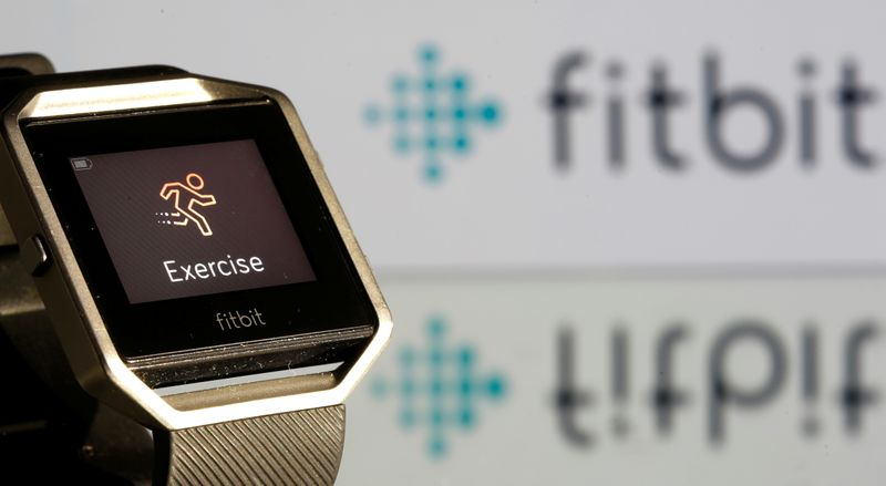 Fitbit Blaze watch is seen in front of a displayed Fitbit logo in this illustration
