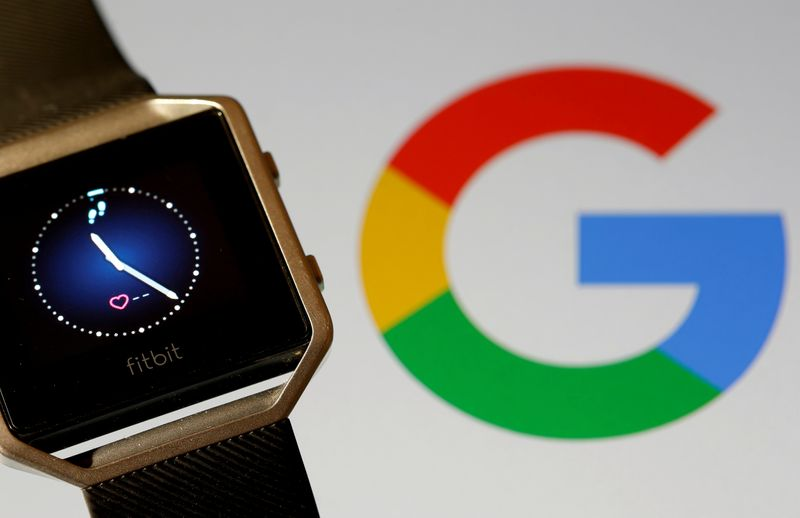 FILE PHOTO: FILE PHOTO: Fitbit Blaze watch is seen in front of a displayed Google logo in this