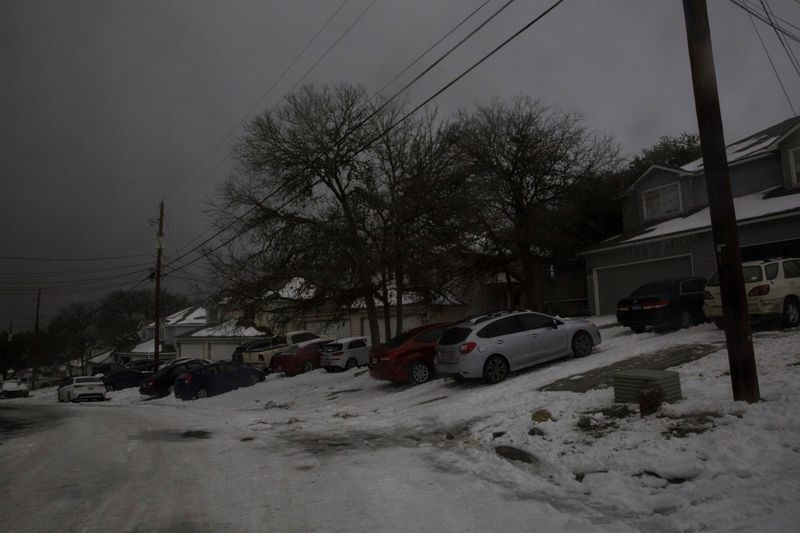 FILE PHOTO: A neighborhood experiences a power outage after winter weather caused electricity