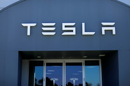 FILE PHOTO: A Tesla sales and service center in Costa Mesa California