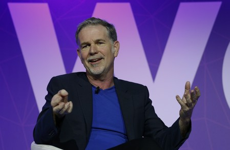 Netflix's CEO Hastings gestures as he delivers his keynote speech during Mobile World Congress